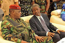 Guinea's acting president General Sekouba Konate, left, speaks with Prime Minister of the transitional government Jean Marie Dore during the inauguration ceremony of Camp Boiro in Conakry, (file photo)