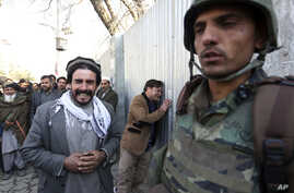 Afghans cry after an attack on a military hospital in Kabul, Afghanistan, March 8, 2017.