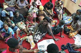 A group of more than 80 Movement for Democratic Change supporters take refuge at party's headquarters in Harare, Zimbabwe, after they were attacked in their homes by suspected ZANU-PF party supporters in Harare, other parts of the country, February,