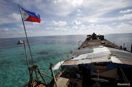 A Philippine flag flutters from BRP Sierra Madre, a dilapidated Philippine Navy ship that has been aground since 1999 and became a Philippine military detachment on the disputed Second Thomas Shoal, part of the Spratly Islands, in the South China Sea