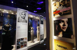 In this March 2, 2016 photo, gowns and outfits of Grammy winning performers are framed by pylons decorated with the covers of the albums of the year winners during each decade at the Grammy Museum Mississippi in Cleveland, Miss.