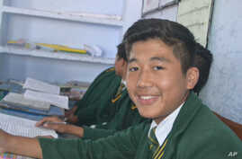 FILE - Dorje Tsering, 16, who died from a cardiac after setting himself ablaze at a housing settlement for Tibetan refugees in northern India, seen at his high school in Dehradun, undated.