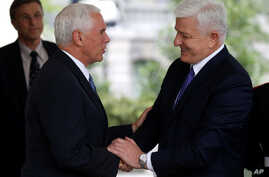 U.S. Vice President Mike Pence shakes hands with Montenegro's Prime Minister Dusko Markovic after a meeting at the White House in Washington, June 5, 2017.  Also on Monday, Montenegro formally became the 29th member of NATO during a State Department