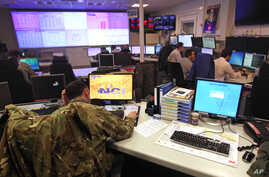 Staff operate at the NATO Computer Incident Response Capability (NCIRC) technical center, at NATO's military headquarters SHAPE in Mons, southwestern Belgium, Dec. 10, 2013.