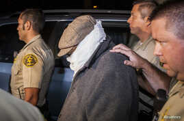 Nakoula Basseley Nakoula (C) is escorted out of his home by Los Angeles County Sheriff's officers in Cerritos, California, September 15, 2012.