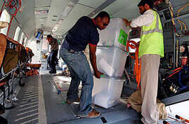 UN workers unload disputed ballot boxes from a UN helicopter at Kabul International Airport before being transferred to the Independent Elections Commission (IEC) warehouse for auditing, in Kabul, Afghanistan, 29 Sep 2009 (file photo)