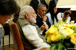 India's Prime Minister Narendra Modi (L) delivers remarks to reporters after meeting with US President Barack Obama (C) in the Oval Office at the White House in Washington, June 7, 2016.