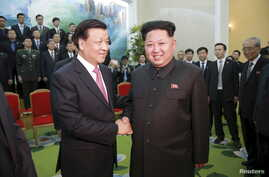 FILE - North Korean leader Kim Jong Un receives a delegation of the Communist Party of China led by Liu Yunshan. Analysts say competition between Beijing and Washington for power and influence in Asia is at the heart of China's recent outreach to Nor