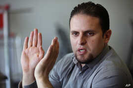 Former Guantanamo detainee and al-Qaida trainee Mourad Benchellali talks during an interview with the Associated Press in Gennevilliers, suburban Paris, France, May 13, 2015.