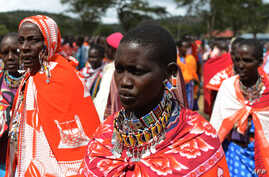 Kenyan Maasai women gather during a meeting dedicated to the practice of female genital mutilation (FGM) in which several participants voiced opposition to a ban currently in place, June 12, 2014, in Enkorika, Kajiado, 75km from Nairobi.