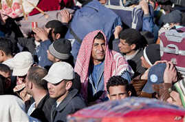 Egyptian, Tunisian and Libyan refugees in Ras Ajdir at the Tunisia-Libya border, Tuesday, March 1, 2011