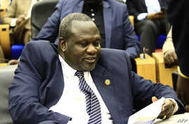South Sudan's opposition leader Riek Machar reads documents in Khartoum, Aug. 30, 2018, as Sudanese and South-Sudanese leaders signed a deal to end their civil war.