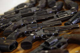 Shown is a collection of guns turned in during the first day of a national disarmament campaign in Rio de Janeiro, Brazil, May 6, 2011. Late last year, Brazil's foreign ministry sent a letter to its embassies instructing them to promote the country's