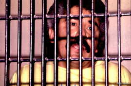 Mexican drug lord Rafael Caro Quintero behind bars in this undated file photo