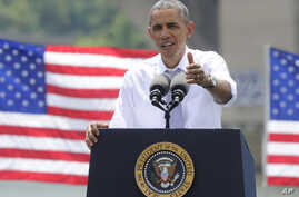 With the Key Bridge, linking Washington and Northern Virginia in the background, President Barack Obama speaks about the economy and transportation at Georgetown Waterfront Park in Washington, July 1, 2014.