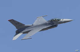 FILE- A U.S. F-16 performs during the Aero India 2017 in Bangalore, India, Feb. 16, 2017. The Trump administration told Congress  Wednesday that it plans to approve a multibillion-dollar sale of F-16 fighter jets to Bahrain without the human rights c