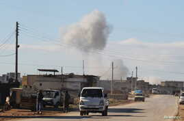 Smoke rises in a site hit by what activists said were airstrikes carried out by the Russian air force in the town of Saraqib, in Idlib province, Syria, Jan. 9, 2016.