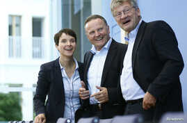 Berlin top candidate of the anti-immigration party Alternative for Germany (AfD) Georg Pazderski (C) and AfD Germany co-leaders Joerg Meuthen (R) and Frauke Petri (L) arrive for their news conference at the Bundespressekonferenz in Berlin, Germany, S