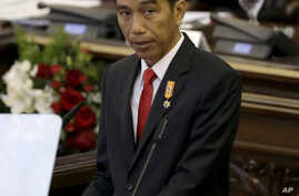 """Indonesian President Joko """"Jokowi"""" Widodo delivers his speech before Parliament members ahead of the country's Independence Day in Jakarta, Indonesia, Aug. 14, 2015."""