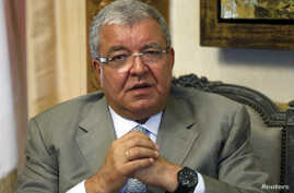 Lebanon's Interior Minister Nohad Machnouk speaks during an interview with Reuters at his office in Beirut July 9, 2014. The success of the Islamic State in Iraq and Syria has emboldened like-minded militants in Lebanon who believe they can emulate i