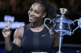 FILE - Serena Williams holds up a finger and her trophy after defeating her sister, Venus, in the women's singles final at the Australian Open tennis championships in Melbourne, Australia, Jan. 28, 2017. Williams wants to help diversify the tech indu