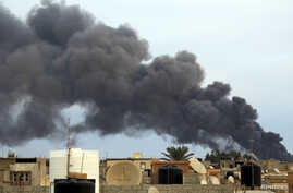 Smoke billows from a factory after an airstrike by forces loyal to former general Khalifa Haftar, in Benghazi, Libya, Oct. 22, 2014.