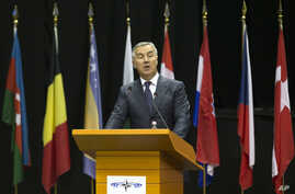 FILE - Montenegro's Prime Minister Milo Djukanovic speaks at the NATO Parliamentary Assembly Spring session in Tirana, May 30, 2016, thanking for his country's invitation to become an alliance member.