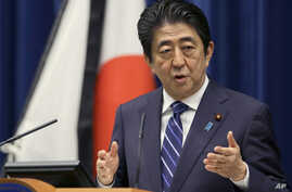 Japanese Prime Minister Shinzo Abe speaks to the media on the eve of the fifth anniversary of the March 11, 2011, earthquake and tsunami, in Tokyo, March 10, 2016. He pledged to bolster reconstruction efforts in northern Japan.