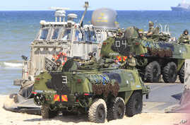 Soldiers sit atop of amphibious vehicles as NATO troops participate in the NATO sea exercises BALTOPS 2015 that are to reassure the Baltic Sea region allies in the face of a resurgent Russia, in Ustka, Poland, June 17, 2015.