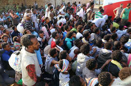 Migrants are seen after they were relocated from government-run detention centers, after getting trapped by clashes between rival groups in Tripoli, Libya, Sept. 4, 2018.