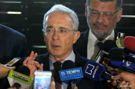 Former Colombian President Alvaro Uribe talks to the media in Rionegro, Colombia, July 30, 2018.