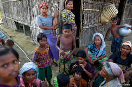 Rohingya  Muslims pass time near their shelter at a refugee camp  outside Sittwe, Myanmar, June 4, 2014.