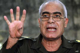 General Mahmoud Shaheen, a member of the military council, speaks during a news conference at the military media center in Cairo, March 28, 2011
