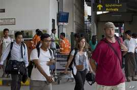 Non-governmental organization staffers arrive in Yangon from Sittwe, March 27, 2014.
