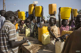 Chlorine is added to water that displaced women who are sheltering at the U.N. base in Malakal had to fetch from the Nile River during a water shortage.  Aid groups fear the 20,000 people sheltering at the U.N. compound could face food shortages unle
