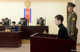 U.S. citizen Matthew Todd Miller (2nd R) sits in a witness box during his trial at the North Korean Supreme Court in Pyongyang, September 14, 2014.