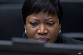 FILE - In this file photo dated Thursday, Chief Prosecutor Fatou Bensouda waits for the start of the trial against former Ivory Coast president Laurent Gbagbo at the International Criminal Court in The Hague, Netherlands. Bensouda says she is launchi
