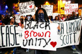 Protesters march in the streets during another night of protests over the police shooting of Keith Lamont Scott in Charlotte, North Carolina, Sept. 23, 2016.