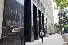 A man walks past the Export-Import Bank of the United States, July 28, 2015, in Washington.