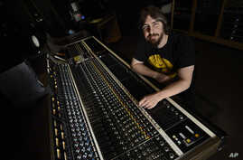 Music producer Dave Cobb poses in the historic RCA Studio A in Nashville, Tennessee, Jan. 29, 2016.