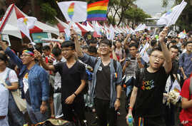Same-sex marriage supporters cheer after the Constitutional Court ruled in favor of same-sex marriage outside the Legislative Yuan in Taipei, Taiwan, May 24, 2017. Taiwan's Constitutional Court ruled in favor of same-sex marriage Wednesday, making th
