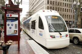 A Tri-Met light rail train rolls through downtown Portland, Ore., April 11, 2012. Two people were stabbed to death and a third person was injured when they tried to stop a man from shouting racial slurs at two women who appeared to be Muslim.