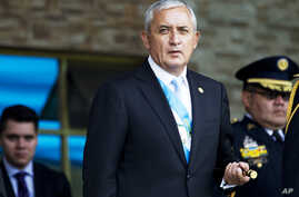 FILE - Guatemala's President Otto Perez Molina arrives at the Army general headquarters in Guatemala City, June 30, 2015.