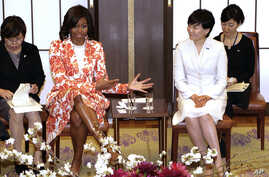 U.S. first lady Michelle Obama, center left, and Japanese counterpart Akie Abe, center right, talk with participants during the roundtable meeting as part of Japan-U.S. Joint Girls Education event at Iikura Guest House in Tokyo, Thursday, March 19, 2