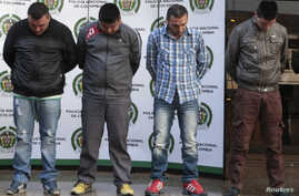 Colombian police present to the media four suspected gang members connected to the death of US drug enforcement agent James 'Terry' Watson, in Bogota in this June 26, 2013, file photo.