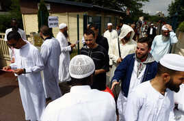 Muslim worshippers walk out after the friday prayer at the Yahya Mosque, in Saint-Etienne-du-Rouvray, Normandy, France, Friday, July 29, 2016. Four days after the hostage taking in Saint-Etienne-du-Rouvray, officials and worshipers of the muslim comm