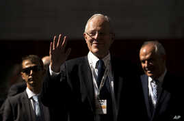 Peru's President Pedro Pablo Kuczynski waves as he arrives to an economic forum about Peru after his meeting with Spain's Prime Minister Mariano Rajoy in Madrid, Spain, June 12, 2017.