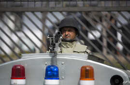 FILE - A Pakistani paramilitary soldier guards a special court set up for the trial of former President Pervez Musharraf in Islamabad, Pakistan, Friday, March 14, 2014.