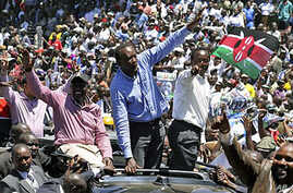 Kenya's former Education Minister William Ruto, center left, Kenya's Deputy Prime Minister Uhuru Kenyatta, center, and Kenya's Vice President Kalonzo Musyoka, center right, wave to thousands of people during a prayer rally at Uhuru Park, Kenya, April