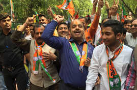 There were raucous celebrations outside Bharatiya Janata Party headquarters as news of the party's huge win in Uttar Pradesh came in on Saturday, in New Delhi, India, March 11, 2017. (A. Pasricha/VOA).